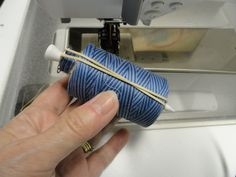 store bobbins with the thread it goes with using a golf tee and rubber band
