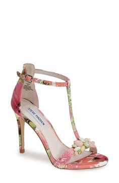 Pastel-hued stones shape delicate flowers at the toe strap of this pretty floral-print sandal.