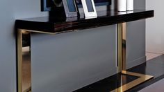 Buy Dom Edizioni Kelly Console Table Online at LuxDeco. Channel ultra-modern cool with the Kelly console table, skilfully crafted from macassar ebony and finished with brass plating.
