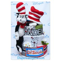 4-tier Dr Seuss diaper cake made specially for baby Linden! Filled with 100 size 2 diapers, x2 Dr Seuss t-shirts, x5 washcloths, x4 burp cloths, X1 Dr Seuss plush toy and a Dr Seuss toddler's hat.