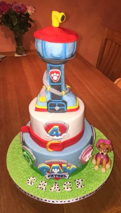 Paw Patrol cake. Two tiers. Tower made from RKT.
