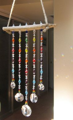 Make this World Market sun catcher in an afternoon with a drill (for the holes in your wood), wire and beads. Make this World Market sun ca Bead Crafts, Fun Crafts, Diy And Crafts, Decoration Creche, Diy Wind Chimes, Mobiles, Crafty Craft, Beads And Wire, Bead Art
