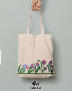 Eco friendly cotton tote market bag with colorful tulips design. Image by Lemon and Blair