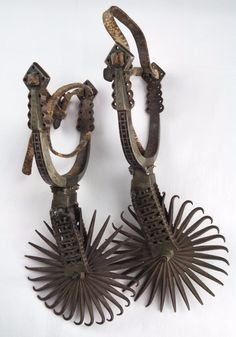 Pair of 19th century hand wrought Spanish Colonial iron spurs, silver inlay, signed