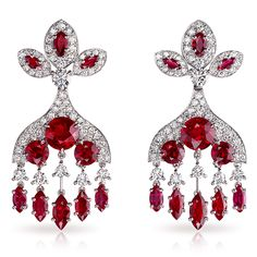 Kokoshnik Earrings. The curved form of the Kokoshnik is translated into elegant pendant earrings, in white gold, set with diamonds and 116 marquise rubies, totalling 3.27 carats and 8 round rubies, totalling 4.26 carats. This piece is set in 18 carat white gold and features 154 diamonds and rubies totalling 9.41 carats.