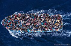 Refugee boat off the island of Lampedusa. Why can't we help ???