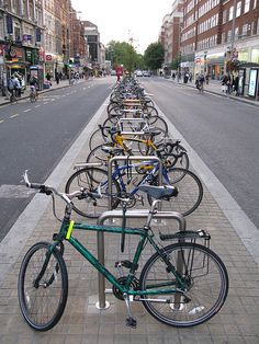 Bicycles parked along Kensington High Street, London. Photo: alexmuller via Flickr. Click image for source and visit the slowottawa.ca boards >> https://www.pinterest.com/slowottawa/