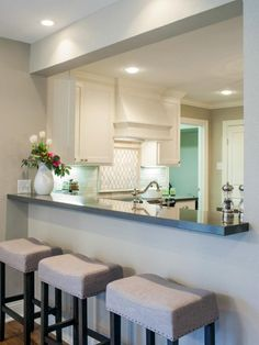 Joanna and Chip opened up a kitchen wall, providing a pass-through opening onto the den. See it at hgtv.com.