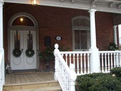Porch Columns, newel posts, spindles and railings supplied by Century Porch Post Inc.