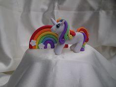 Rainbow colored unicorn cake topper. $25.00, via Etsy.