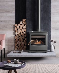 my scandinavian home: Feeling the Hygge: A Toasty Guide To Wood Burning Stoves A fireplace is often Wood Stove Decor, Wood Stove Hearth, Stove Fireplace, Wood Fireplace, Fireplace Design, Wood Stove Wall, Wood Stove Surround, Fireplace Ideas, Modern Fireplaces