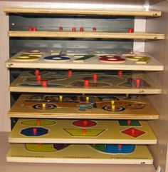 Chunky toddler wood puzzle storage.  Metal file shelves screwed to back of shelves.  2011-11-28-puzzle.jpg