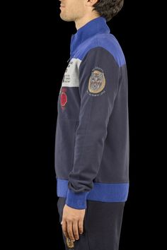 Cotton sweatshirt zipped on the front with two welt pockets. On the left chest, embroidered eagle, brand 'Aeronautica Militare', tricolored cockade and the lettering 'Military Transport Aircraft'. On the right chest, embroidered 'Spartan' and patched '46^ Brigata Aerea' blazon. Styling featured on the left sleeve as the wolf of the 98° Gruppo 'Fero Sed Semper Lupus'. Elastic waistbands and wristbands to let a comfortable fit.  92% Cotton - 8% Elastane W...