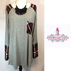 """PLUS 2XHeather & Plaid Contrasting Tunic Dress ‼️PLAID TREND ALERT‼️ Heather & Plaid Contrasting Tunic Dress Adorably cute over leggings with boots or flats Soft microfiber contrasting plaid on a soft heather grey tunic dress Black, burgundy & cream plaid New, no tags  Size 2X Bust 24"""" across, 33"""" long 95% rayon, 5% spandex  ‼️PRICE FIRM UNLESS BUNDLED‼️ Create a bundle for 15% off! Thanks for looking✌️❌NO PAYPAL❌NO TRADES❌ Hourglass Lady Dresses"""