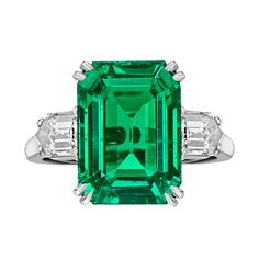 Colombian, emerald-cut emerald ring with fancy-cut diamond shoulders, the emerald weighing 8.20 carats and two diamonds weighing 1.10 total carats, mounted in platinum, numbered 144.034, signed Van Cleef & Arpels. Re-sizable.
