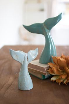 Accessorize your tabletop with this generously-sized ceramic whale tails. Ceramic Whale Tails comes in a set of twoColor: Blue Material: Ceramic Dimensions 9 x 3.5 x 11t small 7 x 2.5 x 7.5t