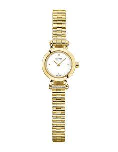 Hermès montre Faubourg or jaune http://www.vogue.fr/joaillerie/shopping/diaporama/montres-ultra-fines-femme-or-jaune-horlogerie/19216/image/1012966