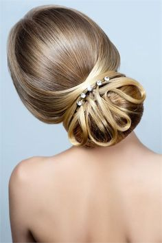 A stylish wedding up-do featuring diamante hair pins to complete the look.