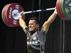 Domingo Roman of Mexico competes in the men's 77kg