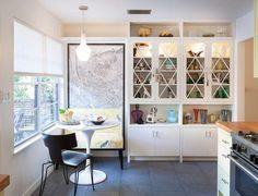 Kitchen cupboards are nice; like small bench w/ map behind- could use that idea in a few places in house.