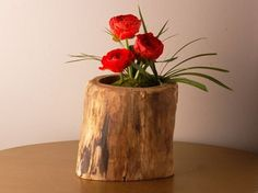 Search your neighborhood or backyard for raw and heavy duty pieces of wood. Hollow out the center, and viola, you have a simple, yet beautiful flower container. Add a protective coat over it for a glossy look, or keep it rustic. Absolutely amazing!