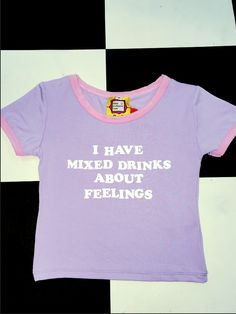 I have mixed drinks about feelings....   Cotton spandex blend Round neck cropped ringer tee All over stretch