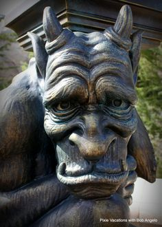 Lamp post gargoyle in #NewFantasyland Looks so sad, like he has the weight of the world on his shoulders.