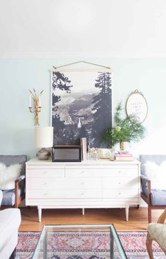 Don't crowd your favorite family photo among a mass of subpar snaps. Choose one to honor properly — printing it oversized in black-and-white gives even the most novice shot a professional look. See more at Lay Baby Lay »   - HouseBeautiful.com