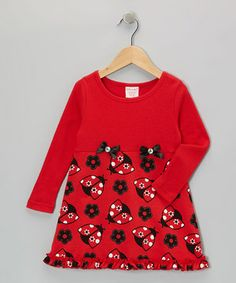 Bows at the waistband and lovely ladybug print score style kudos for this pretty frock. Comfy and carefree, its soft knit fabric with stretchy ribbed bodice is perfect for skipping across playgrounds.