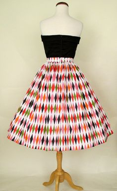 This adorable skirt is the perfect print for a mid century modern look. It has a 1950's inspired gathered skirt that features a fantastic atomic multi coloredharlequin printon a lovely cotton sateen fabric. Pair this skirt with our Perfect 1950's Bustier or our Lauren Bacall blouse for a chic retro look! Dry clean only. Made in the U.S.A. by Pinup Girl Clothing     Size Chart     Size bust waist hips   XS      small  26-27 open   medium  28-29 open   large  30-31 open   x-l...