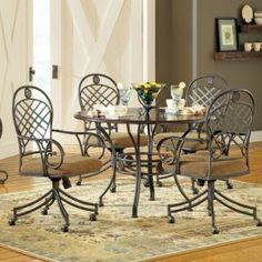The Wimberly Collection is crafted from durable metal and hardwood solids and veneers with a Dark Cherry finish. The Wimberly table top features a criss-cross pattern that matches the same pattern on the chair backs. This 5 piece set includes the Wimberly table and 4 arm chairs with casters and upholstered seats in Brown. Table Size: 30H x 45D x 45W