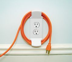 Wall Cleat takes care of all the cords and wires that have cluttered up our lives.