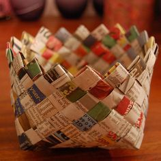 Newspaper Basket Tutorial!    an old newspaper (finally a purpose for that free junk mail)  string or thread  clothespins, paper clips, bobby pins or whatever else you find that can keep the paper together  scissors (even better if you have a rotary cutter and cutting mat!)  staples?