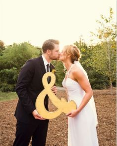 """Use an Ampersand """""""" sign for engagement and wedding photos, so cute!"""