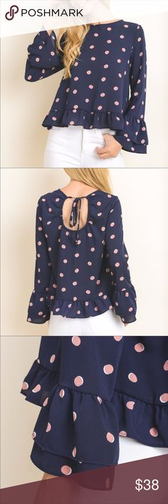 💙NEW ARRIVAL💙 Navy Polka Dot Top Oh so cute navy top in a fun polka dot pattern. Tie back key hole closure and flair sleeves make a flirty statement. Tops Blouses