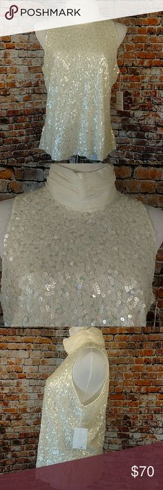 🚛MOVING SALE!🚛NWT Sequin Blouse Plus 18 New with tag fully sequin sleeveless turtleneck halter style top. Madison grey size 18. 100% polyester. Dry-clean-only. Zip back with 3 hook and eye closure at neck. Tiny spot on inside of neckline visible in last photo. 44 inch chest 25.5 inches long. Off-white, cream, ivory Madison Gray Tops Blouses