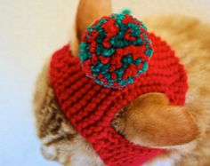 What cat doesnt need a pom pom hat?! This adorable cat costume / cat hat was hand knit with a acrylic blend yarn and fits an average adult cat. Great for a gift or as a treat for your own kitten!  The cat pictured is a 10 lb. adult tabby that measures approximately 2 between its ears on top of its head. While these hats fit the vast majority of adult cats, if you feel your cat would need a larger or smaller size, just indicate the following measurements when you check out: -the distance ...