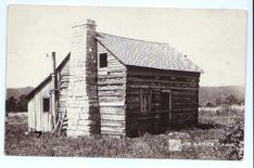 """Two views of the structure known as """"Jim Lane's Cabin;""""  """"Burned soon after this"""" is written in pencil on reverse; Missouri Ozarks area view postcard '20s-'30s (""""Shepherd of the Hills"""" area, near Branson Missouri."""
