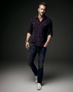 Photographed by Art Streiber for Empire magazine, Ryan Reynolds goes casual in a two-pocket shirt, distressed denim jeans and white sneakers.
