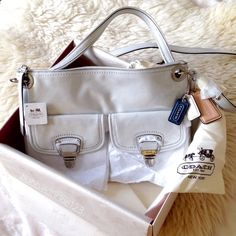"Coach Poppy Leather Hippie *Brand new in original packaging* Coach box & satin bag included, all wrapped in a big bow =) • Luxurious waxed Italian calfskin in metallic Silver/Stardust.   • 2 carrying options: handle (8.5"" drop) or longer detachable strap (22"" drop) for shoulder/crossbody wear • 2 exterior pushlock pockets • Satin lining with inside zip, phone, & multifunction pockets • Zip-top closure • Silver toned hardware  ✅Price firm unless bundled w/ SK-II bag hanger/keychain • Pls msg…"