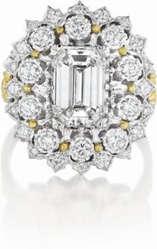 BUCCELLATI Diamond Ring Centering upon a rectangular-cut diamond, weighing approximately 2.14 carats, within a two-tiered circular-cut diamond pierced openwork foliate surround, to the textured gold shoulders accented by circular-cut diamonds, mounted in 18K white and yellow gold