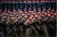 Soviet Army soldiers dressed in Russian Civil War-era Red Army uniforms marching through Red Square in the 1987 Moscow October Revolution Day Parade.