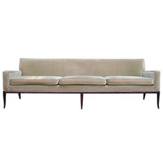 A Classic Sofa by T.H. Robsjohn-Gibbings | From a unique collection of antique and modern sofas at https://www.1stdibs.com/furniture/seating/sofas/