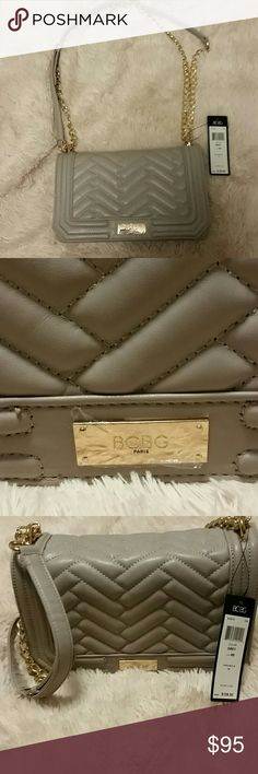 Bcbg Paris crossbody bag. All Grey, with a quilted like feature on the front flap. Gold chain feature added into crossover strap. Nwt BCBG Bags Crossbody Bags