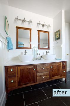 Homeowner Tim Hogan built the vanity in his attic master bath from salvaged walnut; blue milk-glass knobs add a vintage touch. | Photo: Susan Seubert | thisoldhouse.com