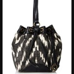 NWT Lucky Brand Bali Hai Sling Bucket Bag Easy styling and use describes this festival flare sling bag by Lucky Brand. 12.5in W x 11.25in H magnetic disc closure, printed, brand logo charm 3 interior pockets cotton/linen, trim: faux leather. Brand new with tags. Lucky Brand Bags Satchels