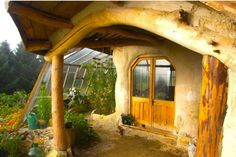 Cob house, love the curved roof and door