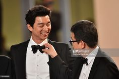 Actor Yoo Gong and Director Sang-ho Yeon attend the 'Train To Busan (BuSan-Haeng)' premiere during the 69th annual Cannes Film Festival at the Palais des Festivals on May 13, 2016 in Cannes, France.