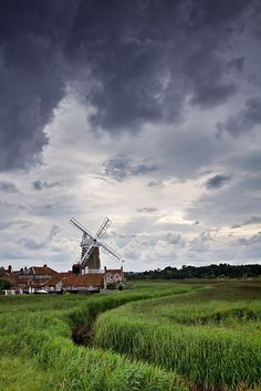 Moody Skies over Cley Windmill, Norfolk, UK The Norfolk Broads are a network of navigable rivers and lakes in the counties of Norfolk and Suffolk
