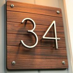 "17 Likes, 3 Comments - Christopher Stephenson (@christopherandcowoodcraft) on Instagram: ""House number completed with Rosewood planks. Beautiful color and rustic meets modern feel"""